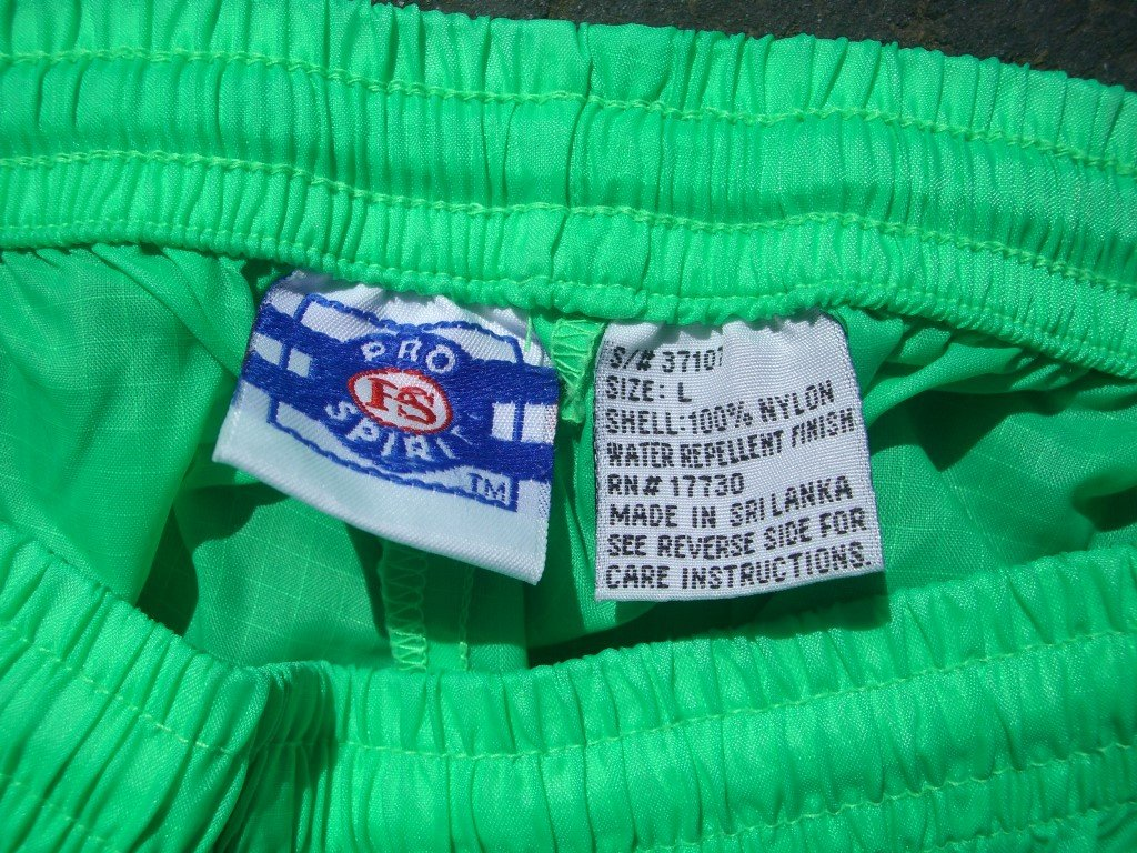 neon-green-pro-spirit-nylon-water-repellent-shorts-tag
